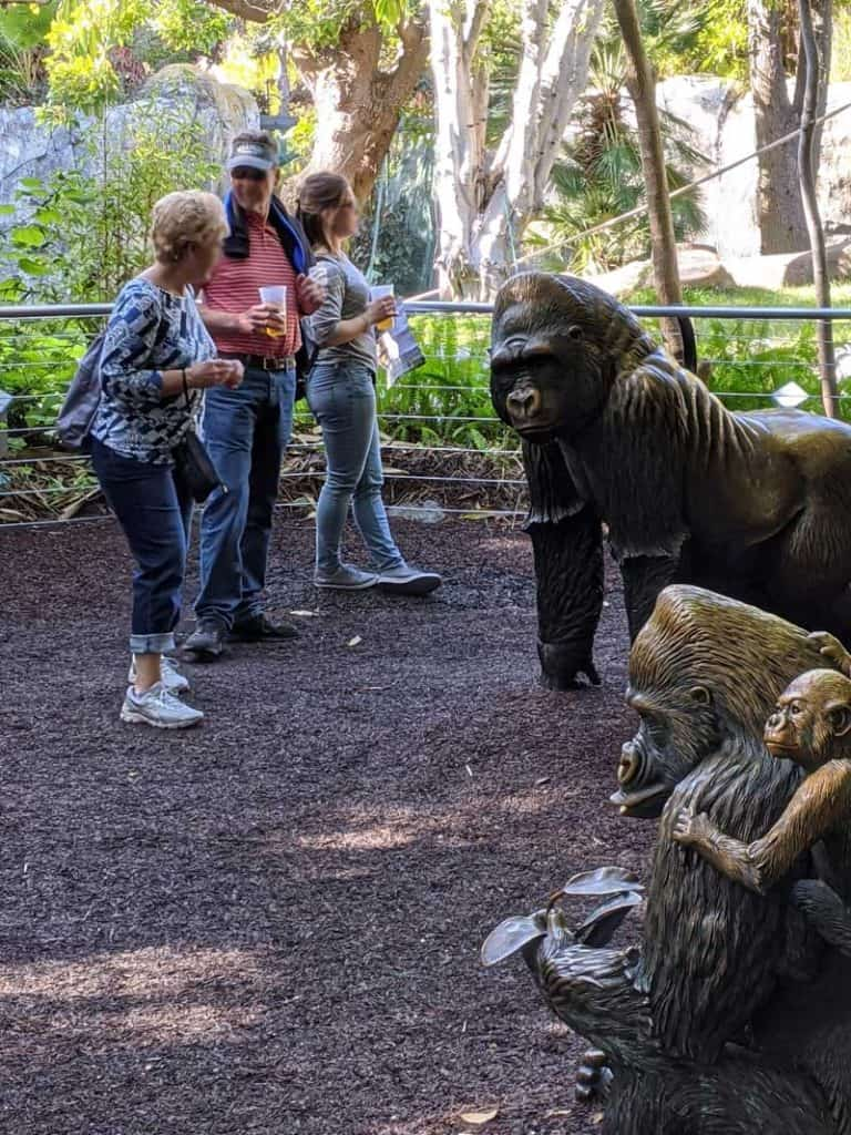 San Diego Zoo visitors at the Western Lowland Gorilla habitat life-size statues.