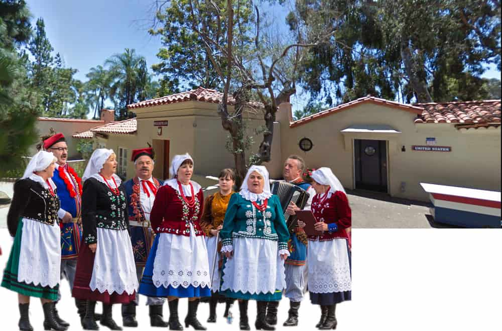 House of Pacific Relations International Cottages. United States and Poland cottages with Polish singers in folk costumes.