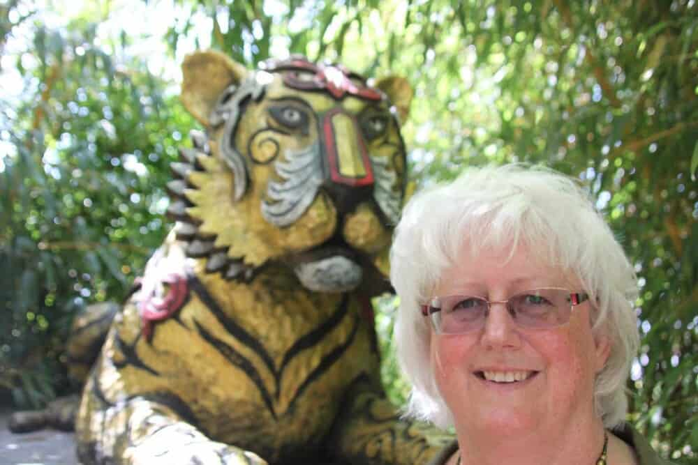 The Sumatran style tiger sculpture in the San Diego Safari Park Tiger Trail exhibit...and me, Nancy Ulrich.