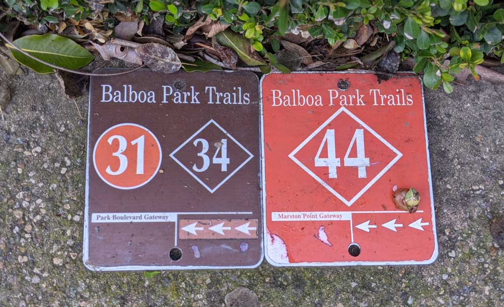 Photo of Balboa Park trail markers embedded in concrete sidewalk